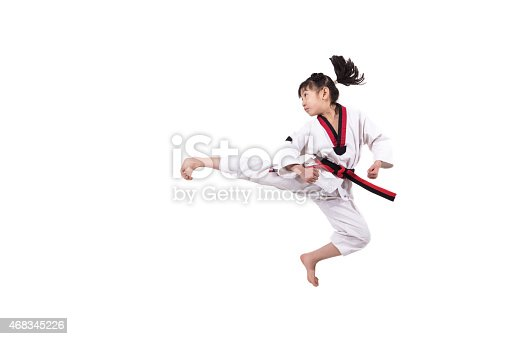 istock The little girl is practising Taekwondo. 468345226