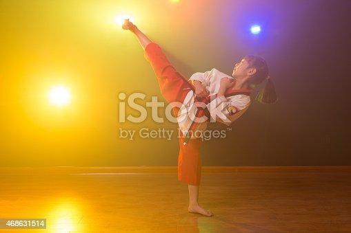 istock The little girl is practising Taekwondo. 468631514