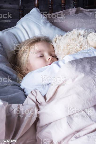 The little girl is sleeping in an embrace with a toy bear cute baby picture id1078243076?b=1&k=6&m=1078243076&s=612x612&h=lhp0l1tyhyz1x4qtsc6y96vmz8xfuzsyhff3yes0if8=