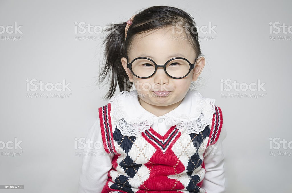 The little girl making faces royalty-free stock photo