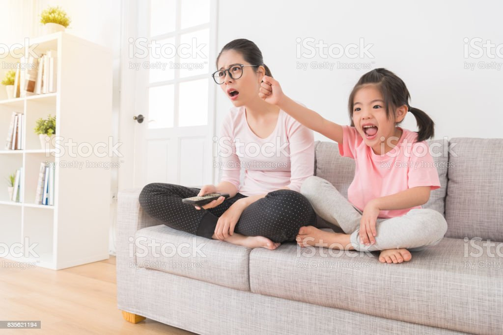 the little girl seeing the favorite team winning stock photo