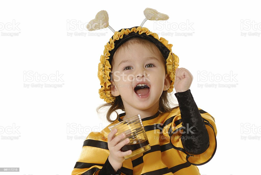 The little girl with a honey glass stock photo