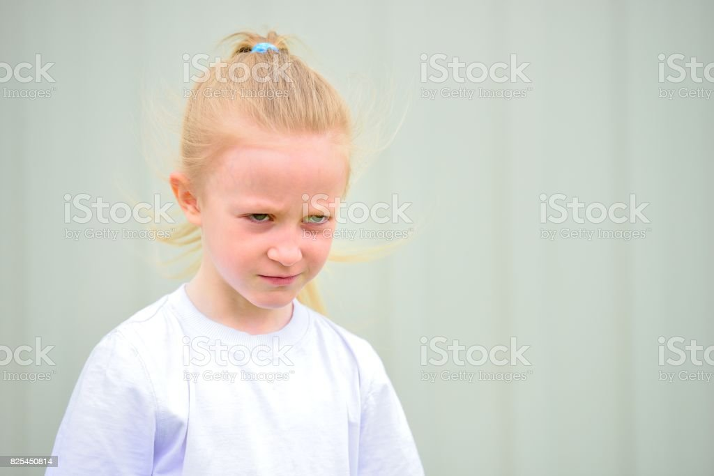 The little girl with evil emotions on a face Стоковые фото Стоковая фотография