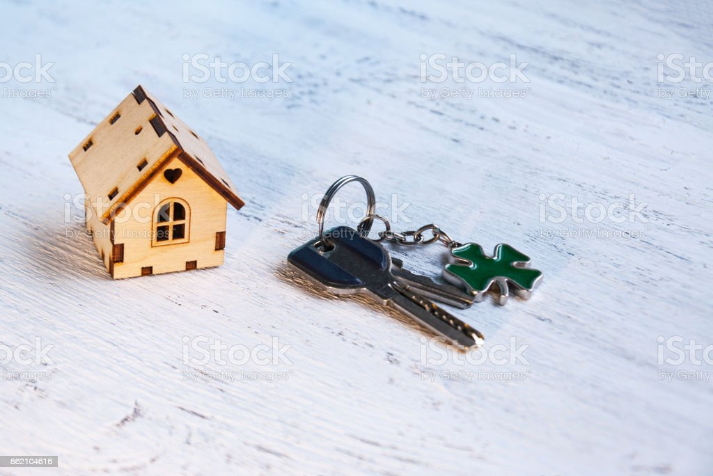 The little house next to it is the keys. Symbol of hiring a house for rent, selling a home, buying a home, a mortgage. stock photo