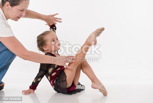 466300721 istock photo The little tired ballerina dancer learning ballet dance 1041940050