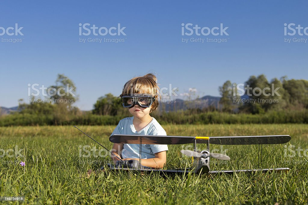 The little villain boy and his new RC plane stock photo