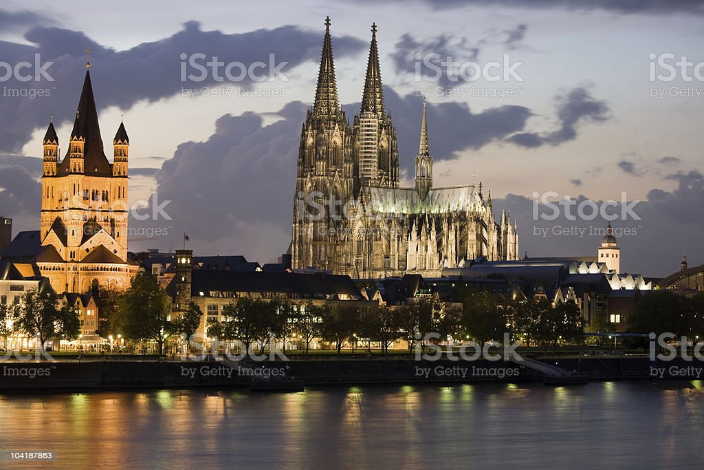 The lit-up Cologne riverbank at night stock photo