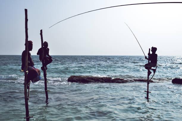 the local fishermen are fishing in unique style - fishman imagens e fotografias de stock