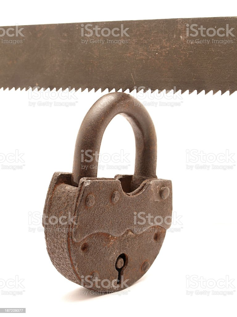 The lock and saw royalty-free stock photo