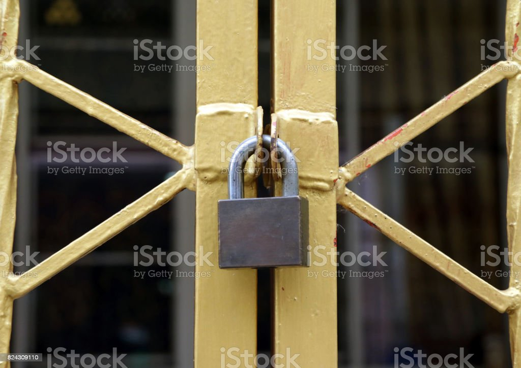 The lock on the gold metal fence. stock photo