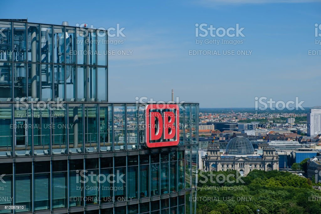 The logo of the Deutsche Bahn AG ( German Railroad Company) on top of the Headquarter office building in Berlin stock photo