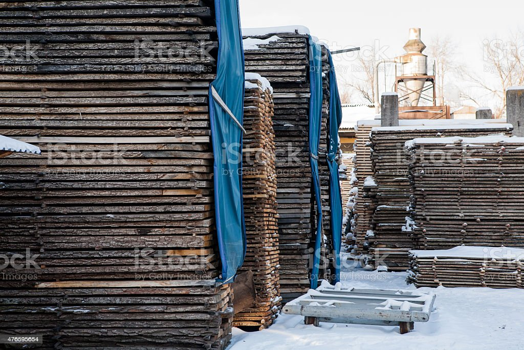 the logs on the snow stock photo