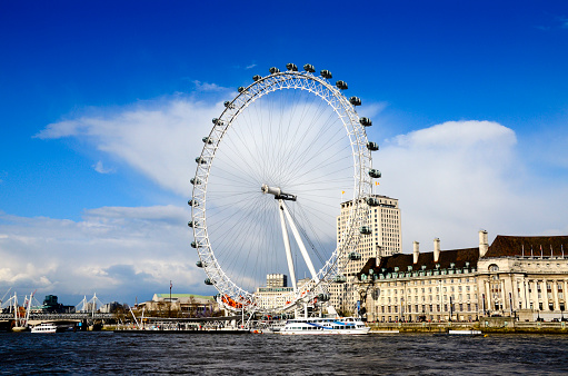 The London Eye on the River Thames, in London England