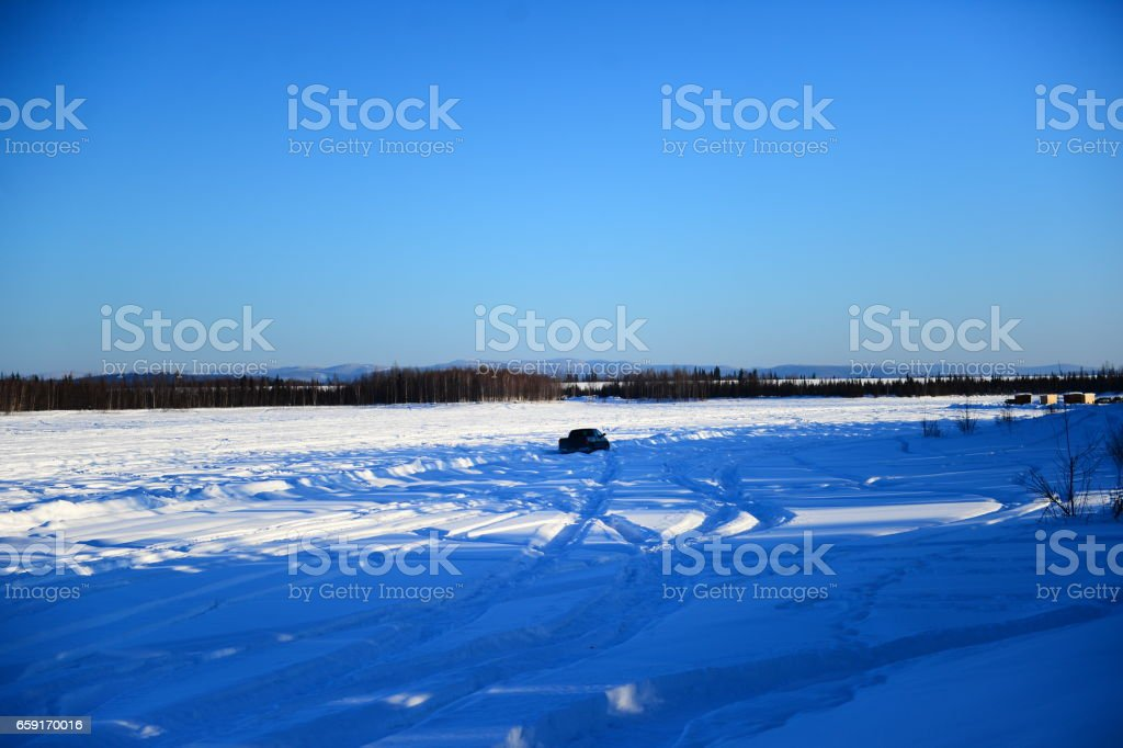 The lonely car on a frozen lake stock photo