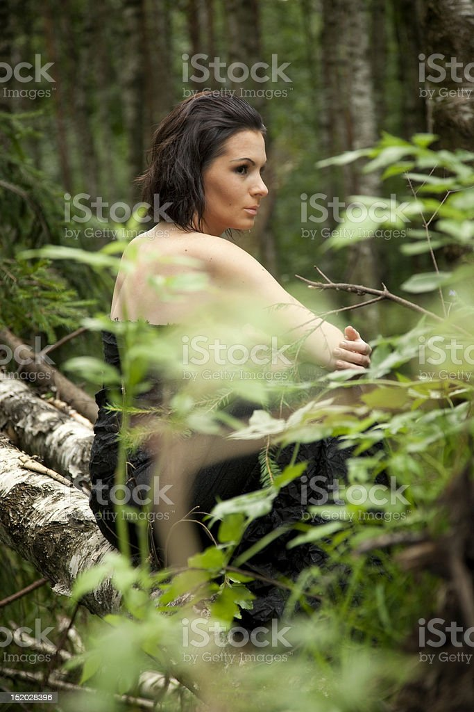 The lonely girl in a forest stock photo