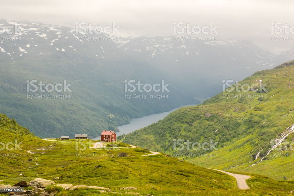 The lonely house on mountain lake in Norway stock photo