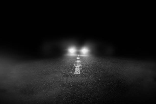 The lonely road at night with the car running. The lonely road at night with the car running. headlight stock pictures, royalty-free photos & images