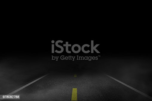 istock The lonely road fog at night 978082788