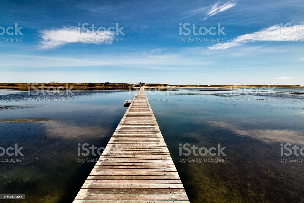 The Long Boardwalk To The Dunes stock photo