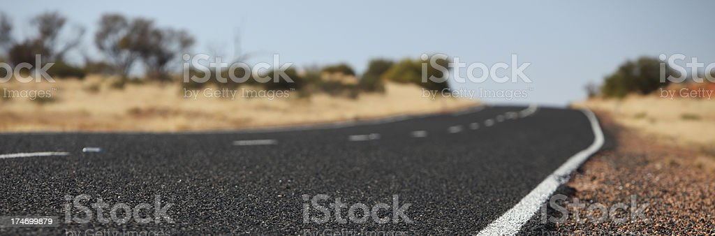 The long desert road stock photo