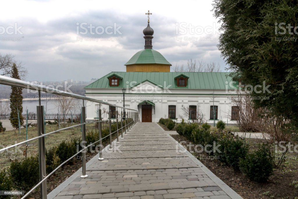 The long path to the church. Gloomy skies over the church. royalty-free stock photo