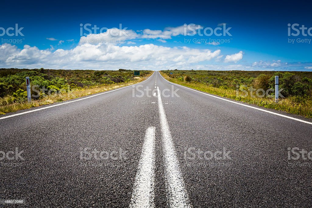 The long road and blue sky in Victoria, Australia stock photo