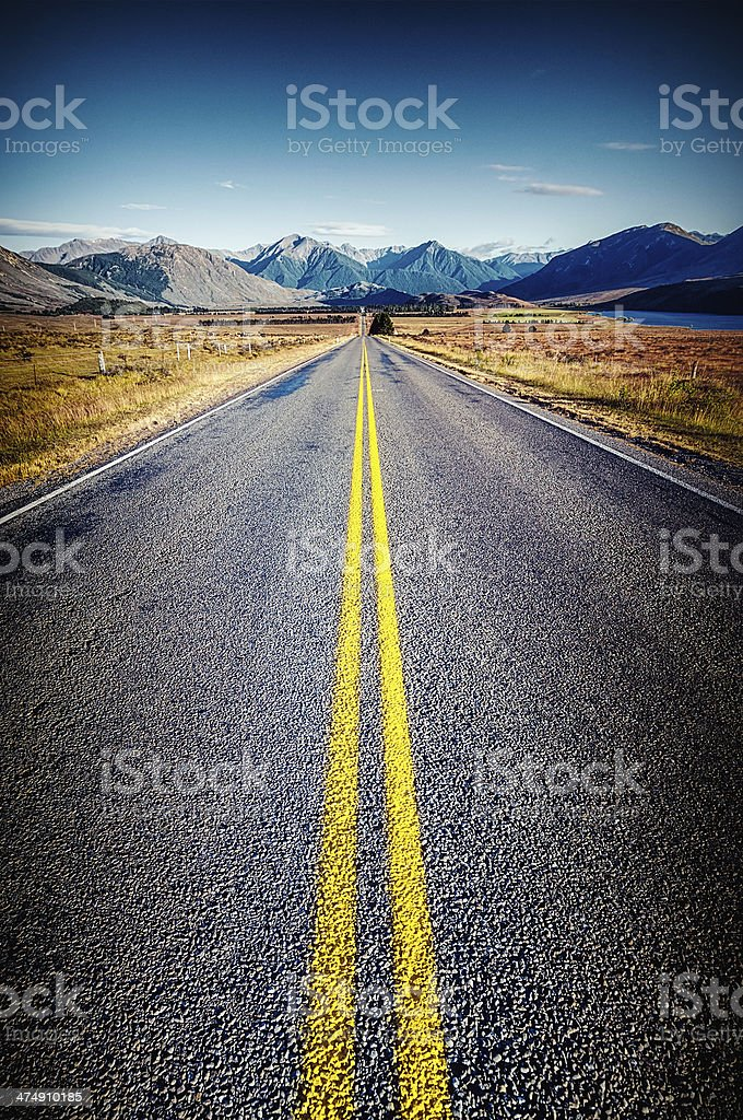A long, straight country road on New Zealand\'s South Island.