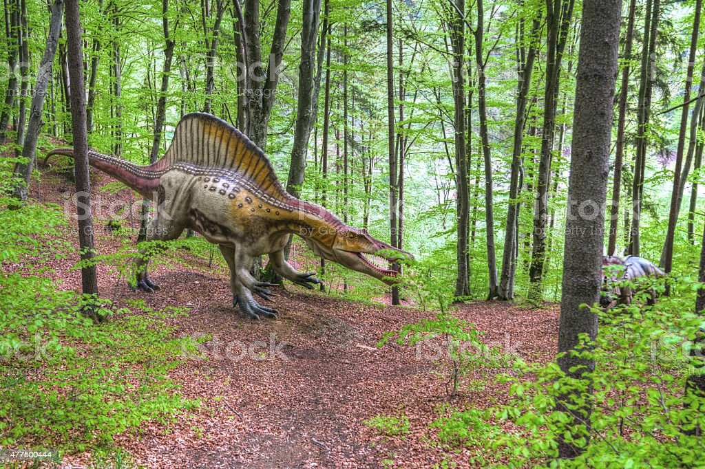 The lost world - dinosaurs forest. Boy fighting a dinosaur stock photo