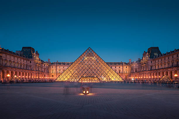 The Louvre, Paris Paris, France - April 14, 2013: The Louvre Museum is one of the world's largest museums, every year museum visits more than 8 million visitors. musee du louvre stock pictures, royalty-free photos & images
