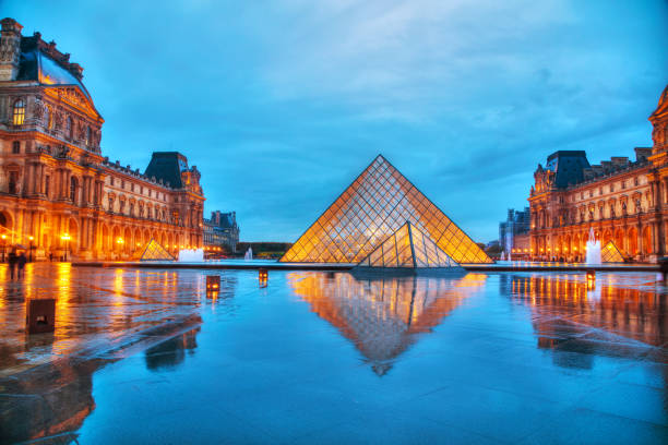 The Louvre Pyramid in Paris, France PARIS - NOVEMBER 4: The Louvre Pyramid on November 4, 2016 in Paris, France. It serves as the main entrance to the Louvre Museum. Completed in 1989 it has become a landmark of Paris. musee du louvre stock pictures, royalty-free photos & images