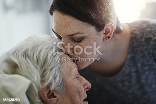 Shot of a daughter visiting her senior mother in hospital