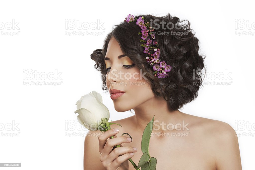 The lovely sexy girl smells a white rose royalty-free stock photo