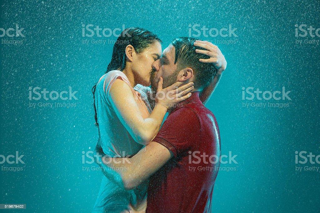 The loving couple in the rain stock photo