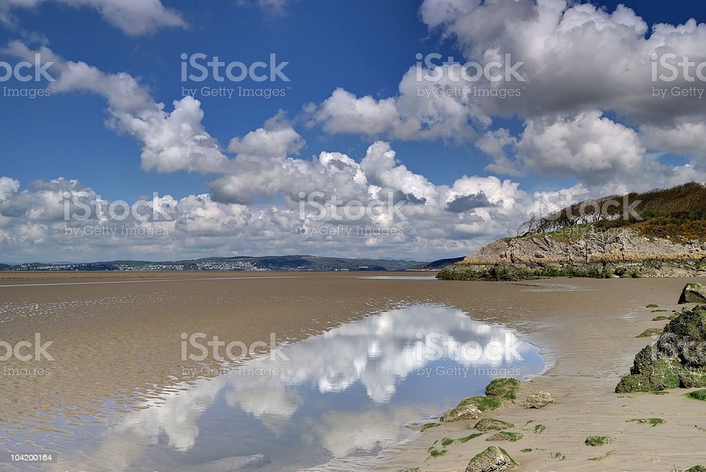 The low tide at Silverdale with the sky reflecting on water stock photo