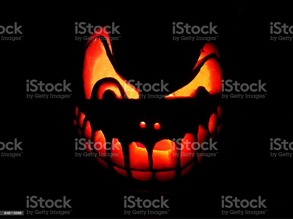 The luminous head of Jack on a black background. Jack is the main symbol of the holiday Halloween stock photo