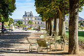 Paris, France - August 12, 2018: The Luxembourg garden is greatly prized by parisians and tourists for its shady tree lined alleys, its metal lawn chairs and its view over the Luxembourg palace.