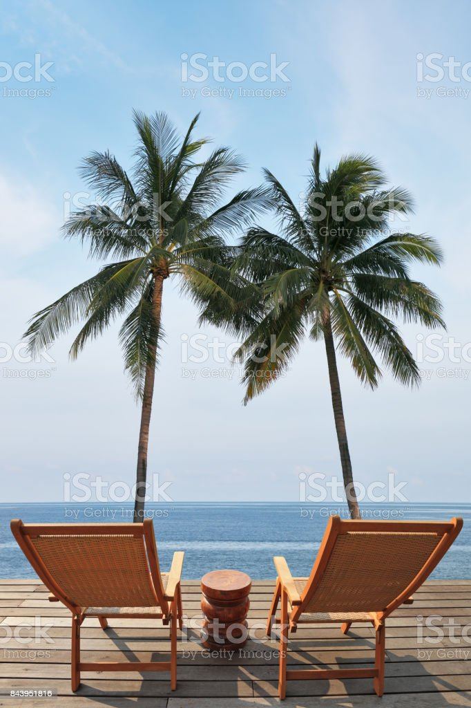 The luxury beachfront pool and the ocean stock photo