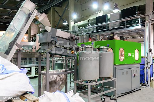 istock The machine for blowing plastic PET bottles 652327776
