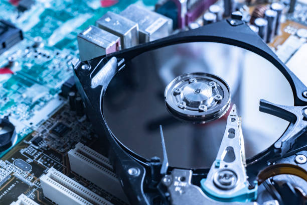the macro view of thye hdd drive with information data, magnetic disc, electronic board background stock photo