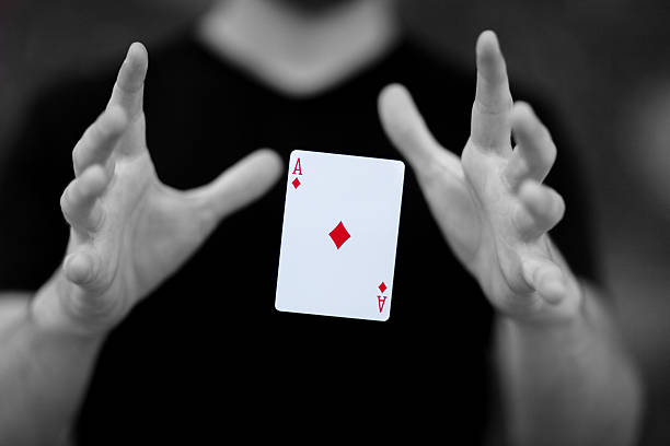 The Magic Number Magician levitating a card magically though mid-air magician stock pictures, royalty-free photos & images