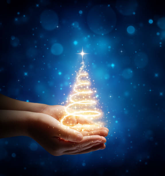 The Magic Of Christmas In Child Hands Magic Christmas tree In Child Hands paranormal stock pictures, royalty-free photos & images