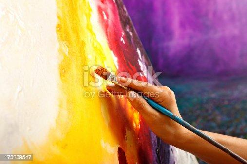 Fine art painter painting in studio, Close-up, Shallow DOF,