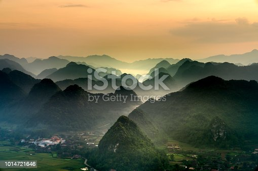 The magical scene of the mountains resemble the successive message they are covered with layers of lush green vegetation at dawn in Bac Son district Lang Son Province, Vietnam