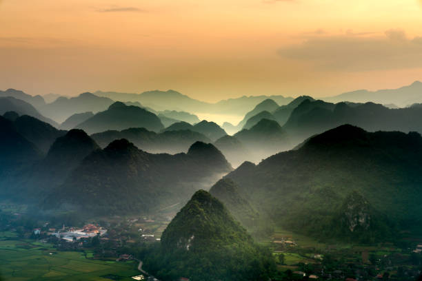 The magical scene of the mountains resemble the successive message they are covered with layers of lush green vegetation stock photo
