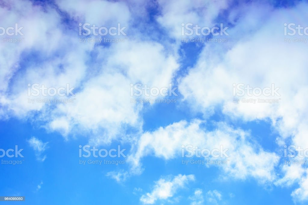 The magnificent blue sky with amazing white clouds surrounds our planet - Royalty-free Atmospheric Mood Stock Photo