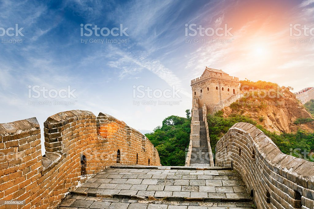 The magnificent Great Wall of China in the sunset stock photo