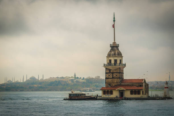 The Maiden's Tower under grey cloudy sky, Bosphorus, Istanbul, Turkey stock photo