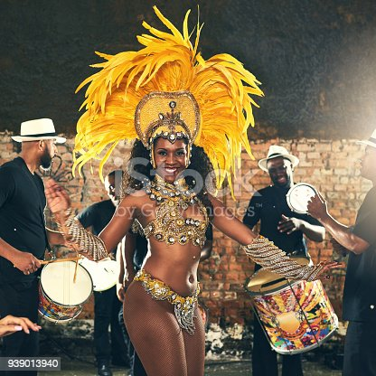 Cropped portrait of a beautiful samba dancer performing at Carnival with her band