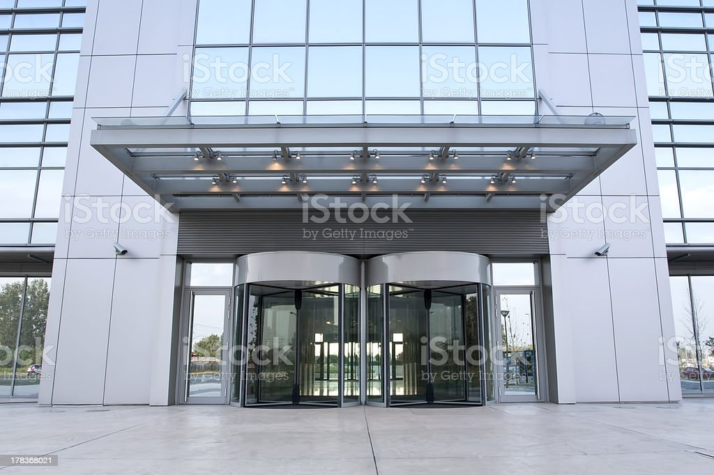 The main entrance of a modern business building stock photo