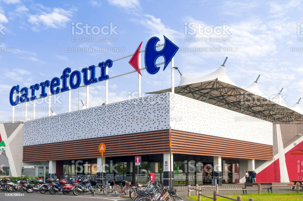 The main entrance to a Carrefour mall in Italy MaSSA, ITALY - JULY 26, 2018 - The main entrance to a Carrefour mall in Italy Advertisement Stock Photo